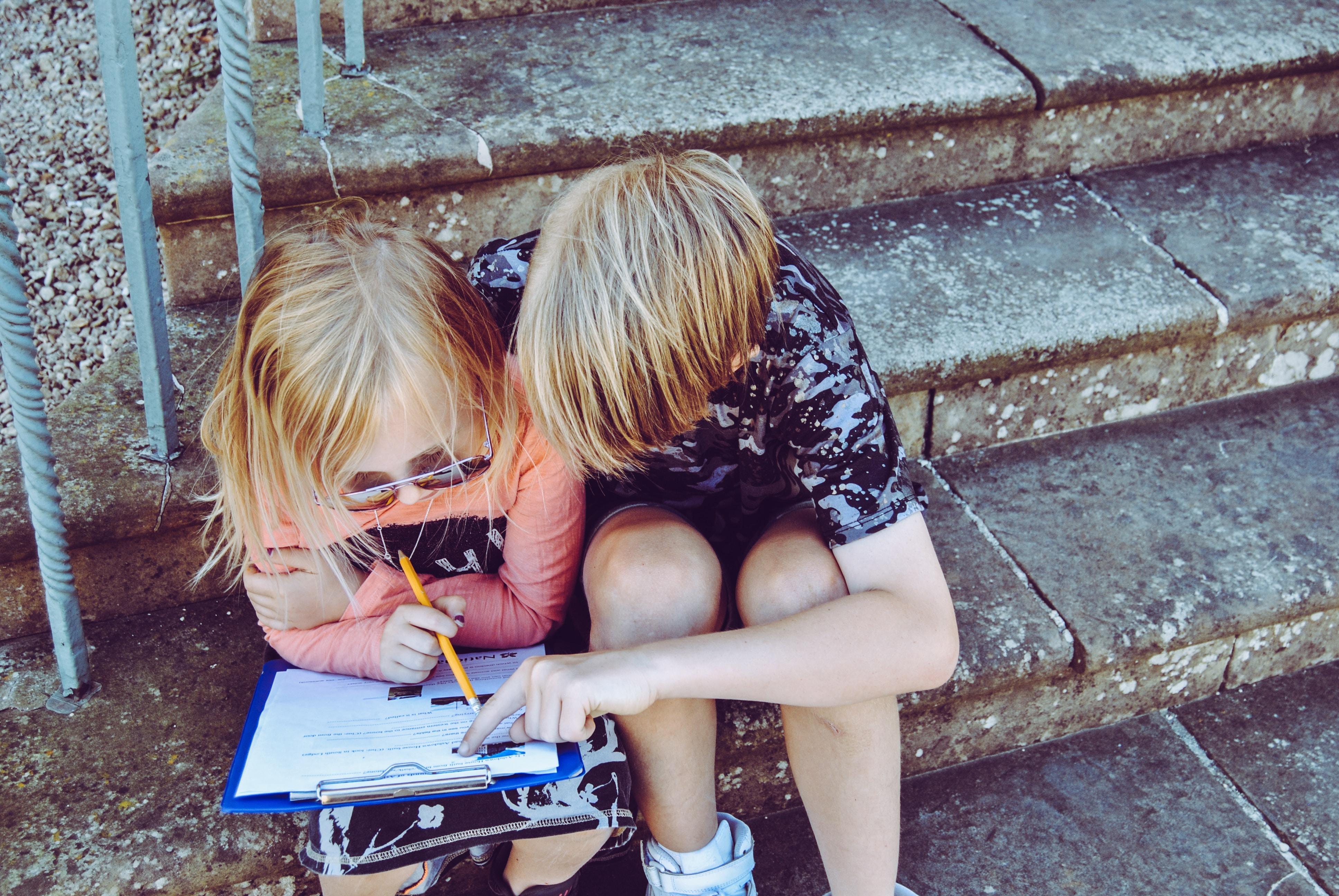 two kids doing homework